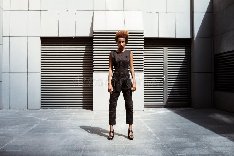 Beautiful african girl posing looking at camera. Fashion street style. royalty free stock photos