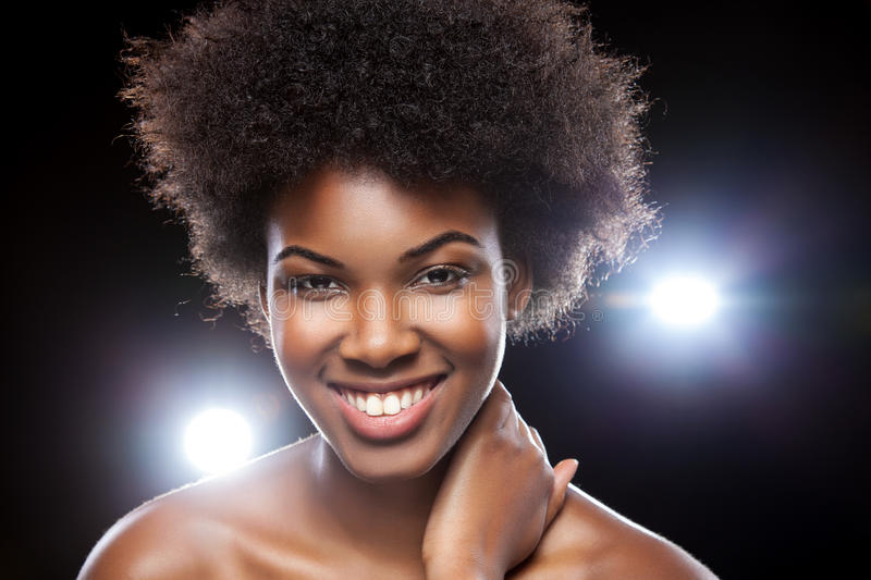 Beautiful African woman with afro hairstyle royalty free stock photo