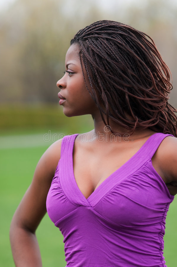 Beautiful african woman outdoors in profile royalty free stock photography