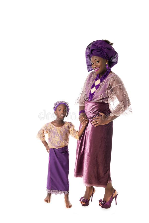 Beautiful African woman and lovely little girl in traditional clothing,isolated royalty free stock image