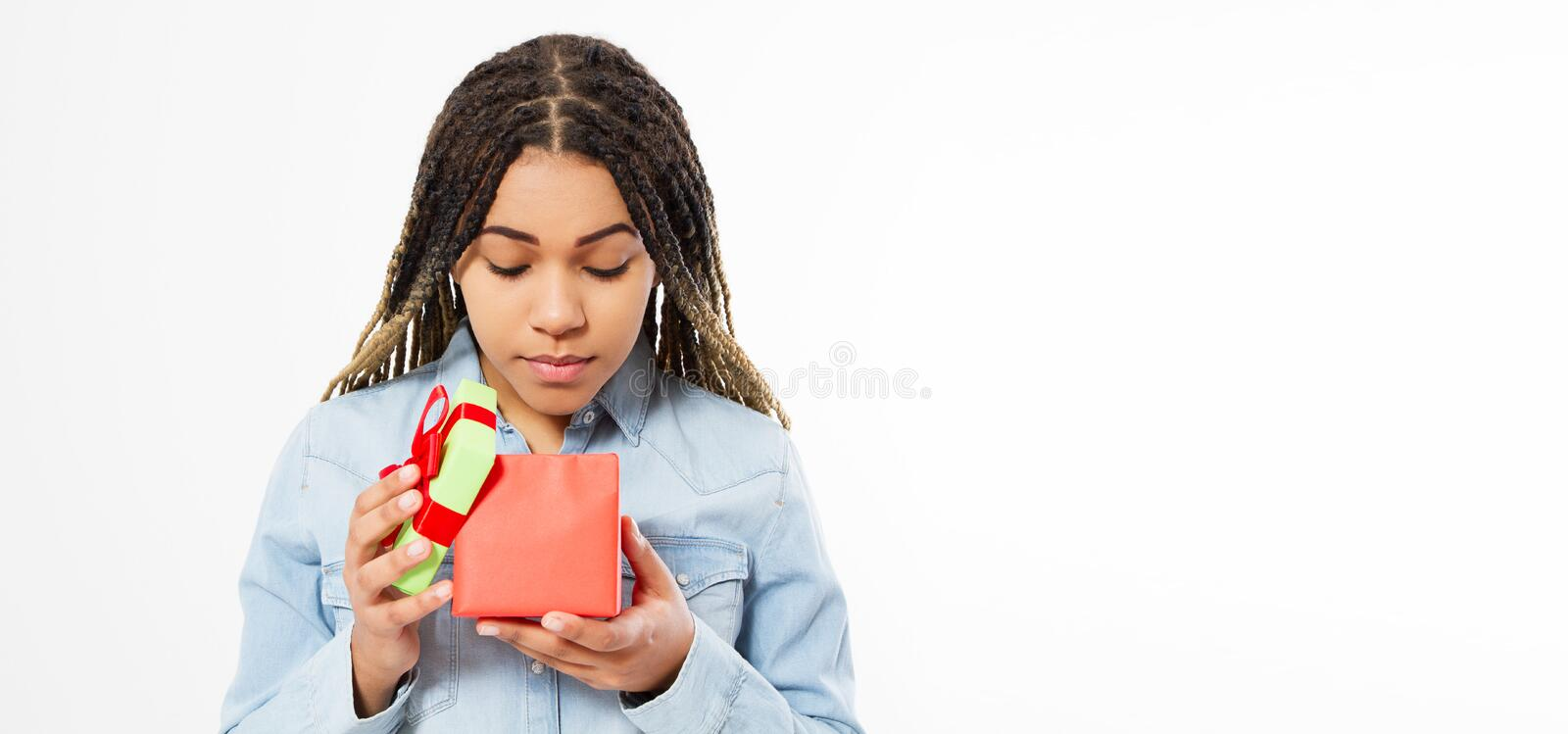 Beautiful Afro American Girl Opens A Gift Box Copy Space Mock Up, Holiday Celebration Concept.  royalty free stock images