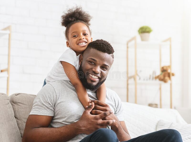 Beautiful afro family of two posing at home royalty free stock photography