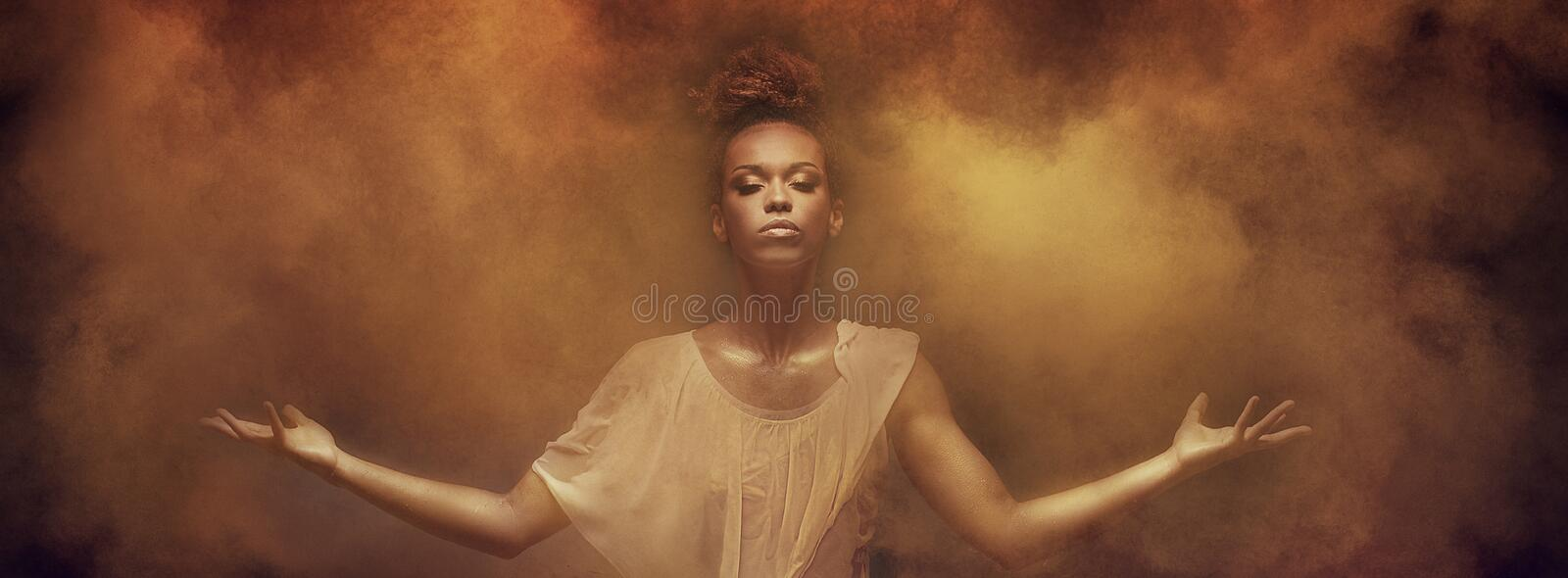 Beautiful afro girl dancer over dust. stock photography
