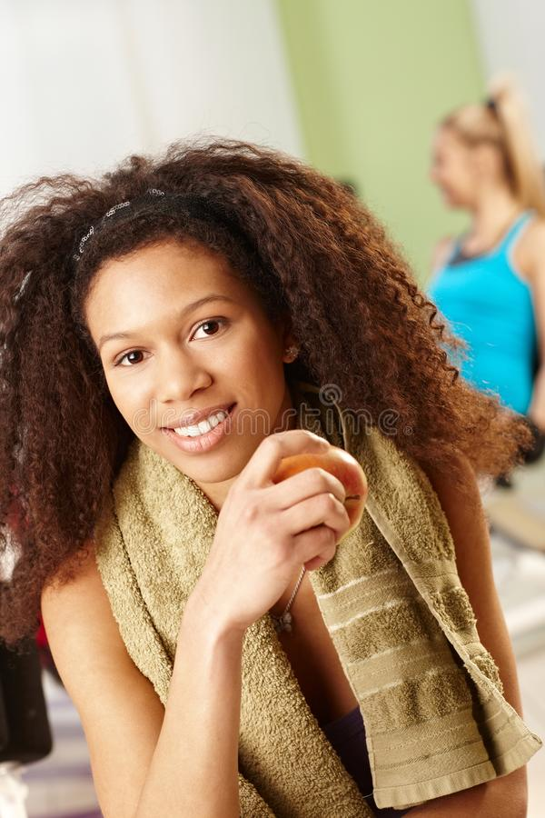 Beautiful afro girl resting at gym