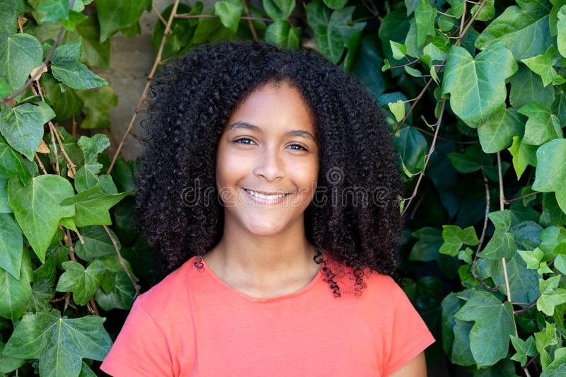 Beautiful afro teenager girl. During a sunny day stock photography