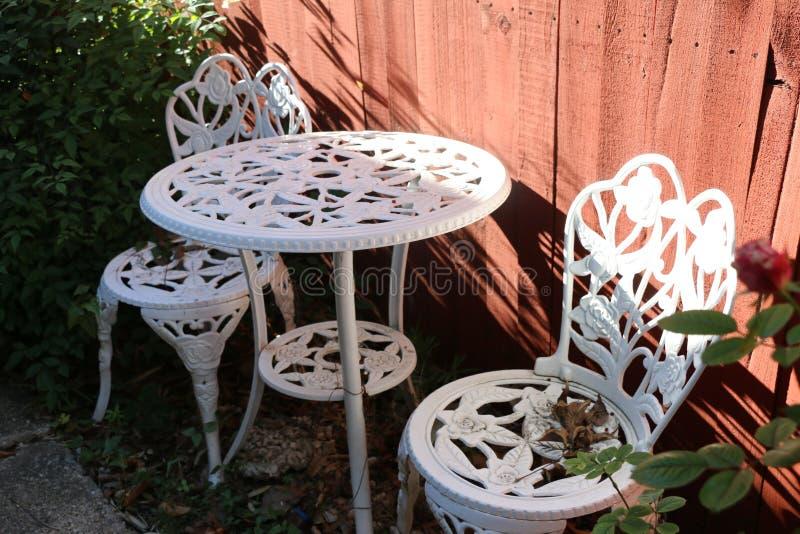 Beautiful afternoon backyard chair garden royalty free stock image