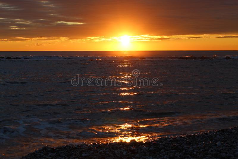 A beautiful afternoon at the beach. This beautiful afternoon at beach watching the sun go down. Sunset with many beautiful colors royalty free stock image