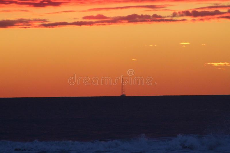 A beautiful afternoon at the beach. This beautiful afternoon at beach watching the sun go down. Sunset with many beautiful colors royalty free stock photo