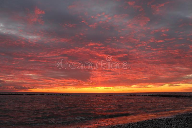 A beautiful afternoon at the beach. This beautiful afternoon at beach watching the sun go down. Sunset with many beautiful colors royalty free stock photos