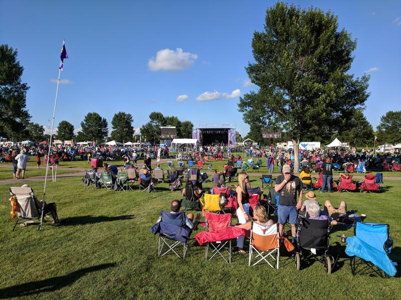 Early in the day at Sioux Falls JazzFest. A beautiful afternoon in front of the main stage at Yankton Trail Park for the free 2 day concert event royalty free stock photo