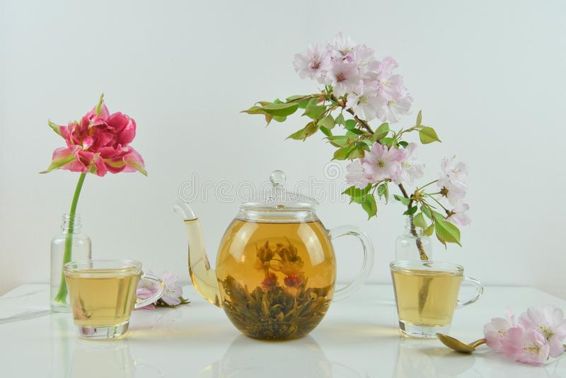 Beautiful afternoon tea with flowers royalty free stock image