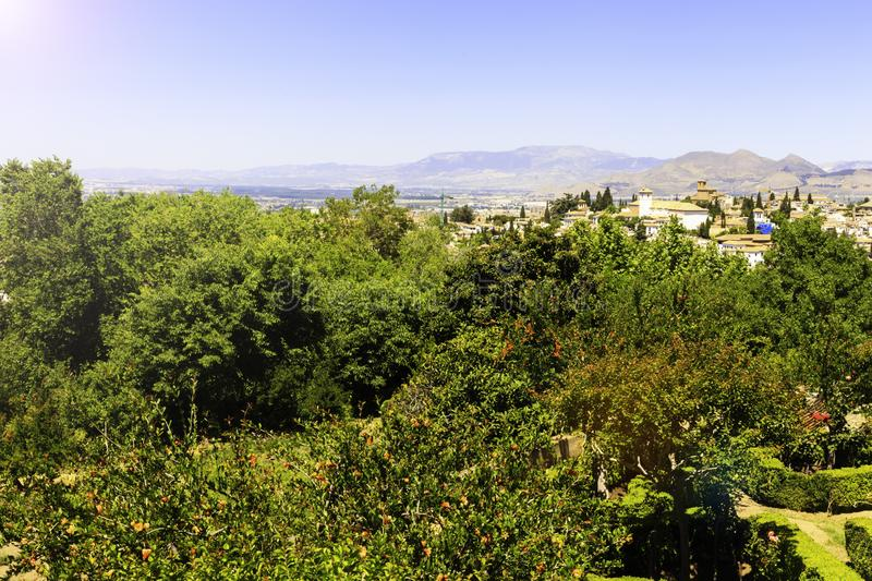 Beautiful Alhambra palace and surrounding mountains in Granada, Spain.  royalty free stock image