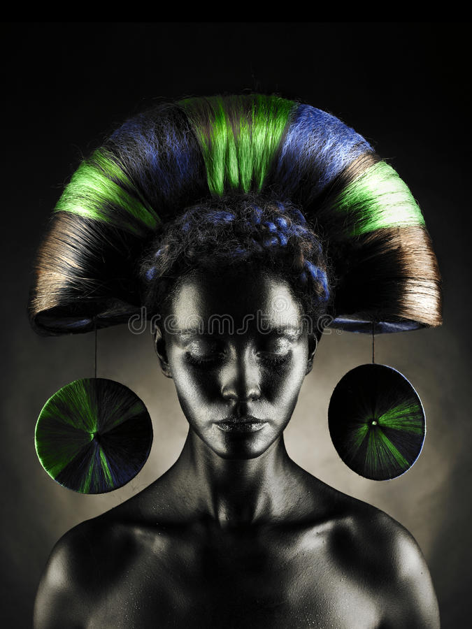 Beautiful alien lady. Portrait of a beautiful alien lady with an unusual hairstyle royalty free stock photography
