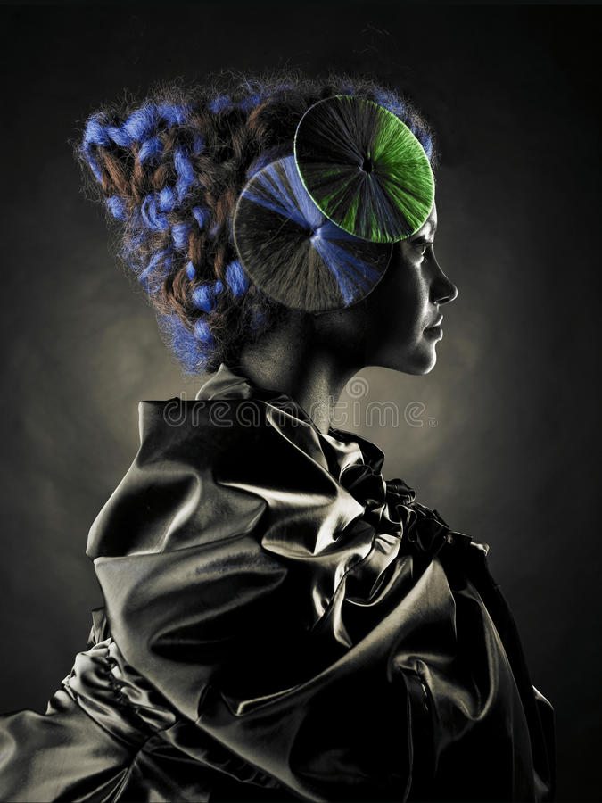 Beautiful alien lady. Portrait of a beautiful alien lady with an unusual hairstyle stock images