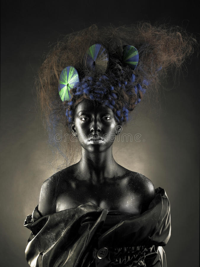 Beautiful alien lady. Portrait of a beautiful alien lady with an unusual hairstyle royalty free stock photos