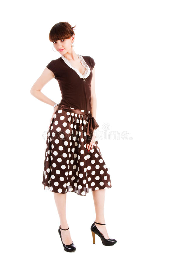 Beautiful alluring girl in spotted skirt stock images