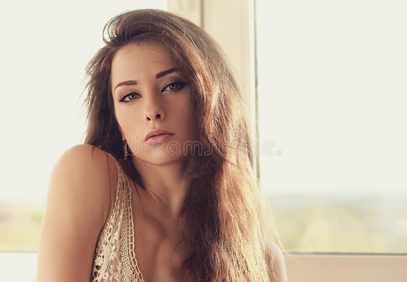 Beautiful alluring young woman looking stock image