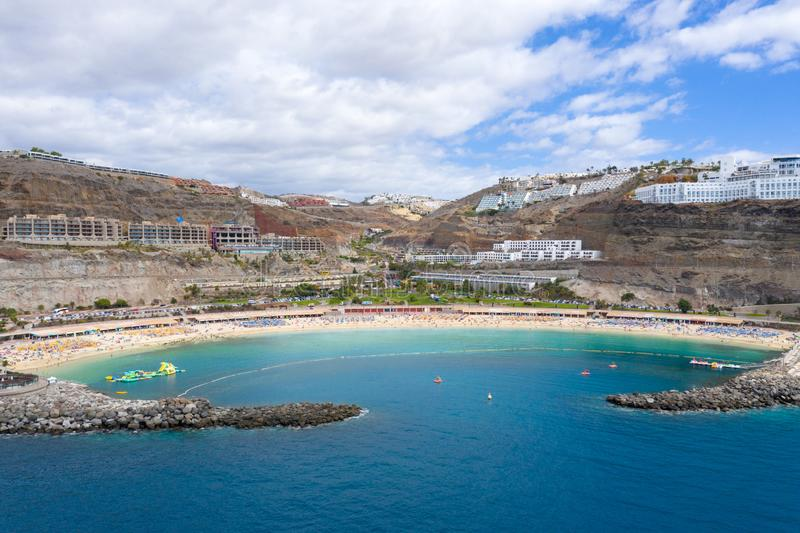Beautiful Amadores beach at Gran Canaria from the Air. Beautiful and idyllic Amadores beach at Gran Canaria from the air. Resorts and hotels along the beach stock image