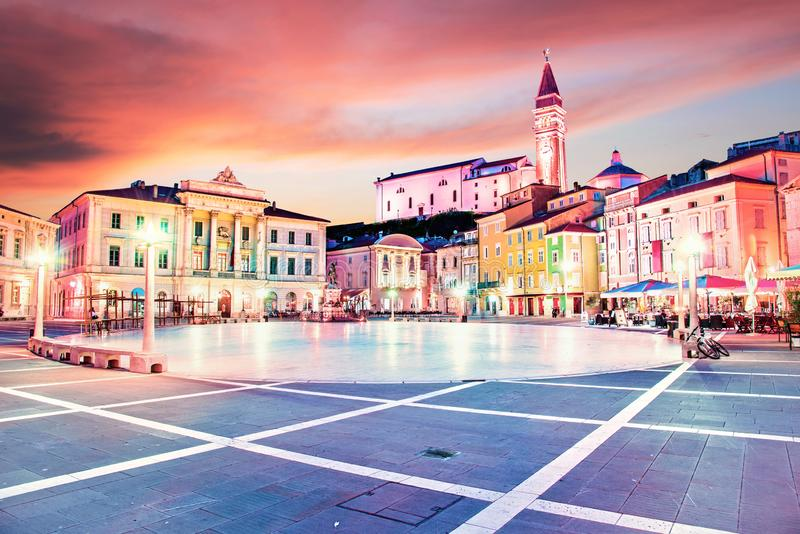 Beautiful amazing city scenery in the central square with the old clock tower in Piran, the tourist center of Slovenia in the stock photography