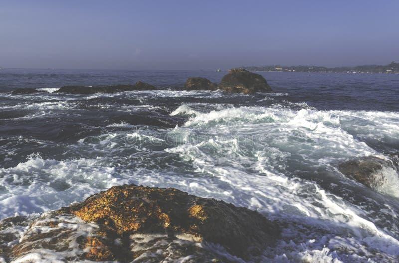 Beautiful amazing landscape of rocky shore at beach stock image