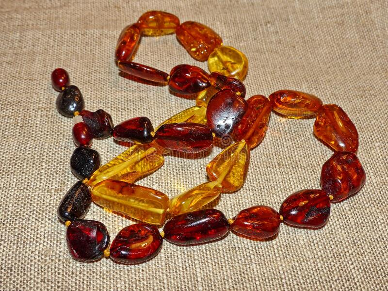 Beautiful amber beads. Gift favorite. Amber is a fossil resin, solidified juice of ancient coniferous tree. S of the upper Cretaceous and Paleogene periods. Used royalty free stock photo