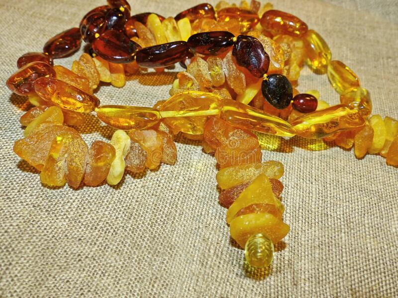 Beautiful amber beads. Gift favorite. Amber is a fossil resin, solidified juice of ancient coniferous tree. S of the upper Cretaceous and Paleogene periods. Used royalty free stock images