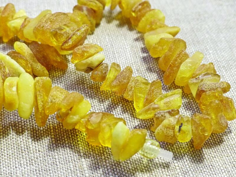 Beautiful amber beads. Gift favorite. Amber is a fossil resin, solidified juice of ancient coniferous tree. S of the upper Cretaceous and Paleogene periods. Used royalty free stock photography