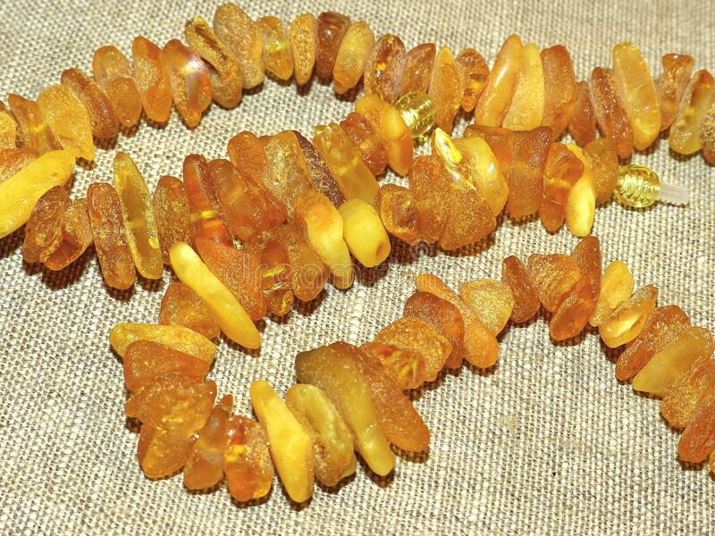 Beautiful amber beads. Gift favorite. Amber is a fossil resin, solidified juice of ancient coniferous tree. S of the upper Cretaceous and Paleogene periods. Used stock photo