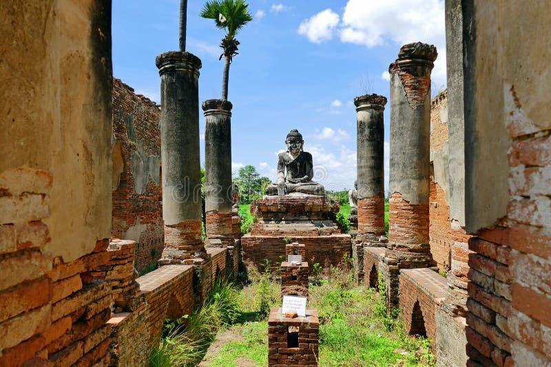 Beautiful Ancient Buddhist Ayutthaya Style Buddha Statue in the Ancient Ruins of Yadana Hsemee Pagoda in Inwa, Myanmar in Summer. Beautiful Scenery Scenic View royalty free stock photo