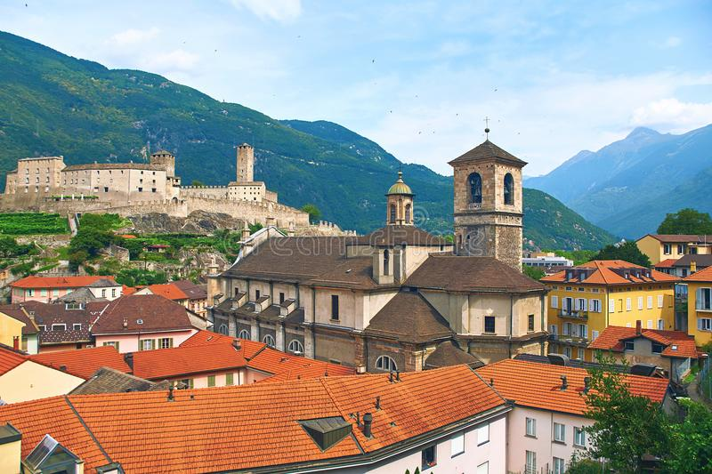 Beautiful ancient city of Bellinzona in Switzerland with Collegiata dei Ss. Pietro e Stefano church and Castelgrande royalty free stock photography