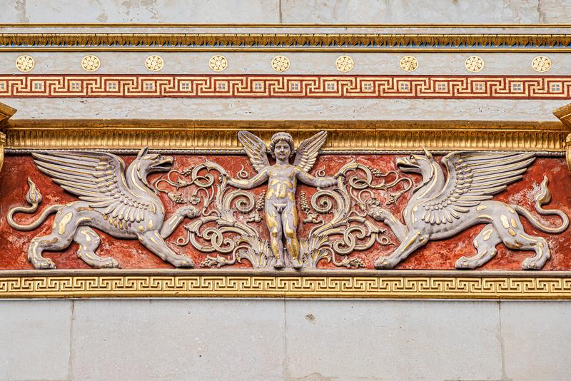 Beautiful angel as defender with mystical dragons at the roof top of main facade of Parliament in Vienna, Austria stock image