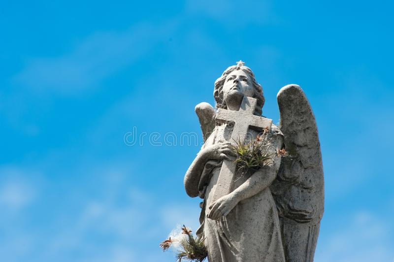 Angel statue with cross on Cemetery in Buenos Aires, Argentina royalty free stock photo