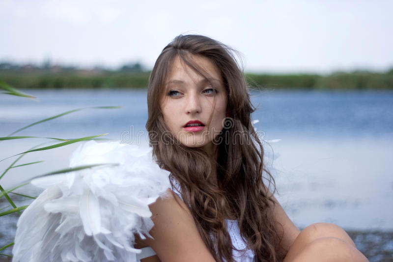 Beautiful angel at the river stock photos