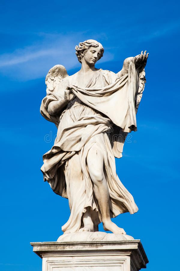 Angel with the Sudarium statue created by Cosimo Fancelli on the 16th century at Sant Angelo Bridge in Rome. Beautiful Angel with the Sudarium statue created by stock images