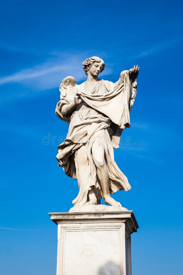 Angel with the Sudarium statue created by Cosimo Fancelli on the 16th century at Sant Angelo Bridge in Rome. Beautiful Angel with the Sudarium statue created by royalty free stock photography