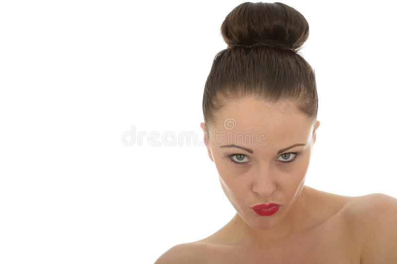 Beautiful Angry Young Woman Glaring At The Camera in A Very Bad royalty free stock photo