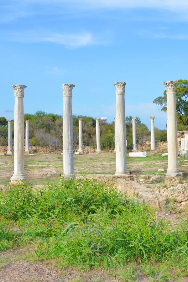 Beautiful Antique pillars with blue sky above. The columns were part of Salamis Gymnasium located near Famagusta in Cyprus. Beautiful Antique pillars with blue stock images
