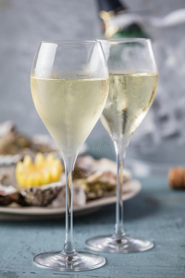 Beautiful appetizer oysters and glasses champagne on Festive Table stock photos