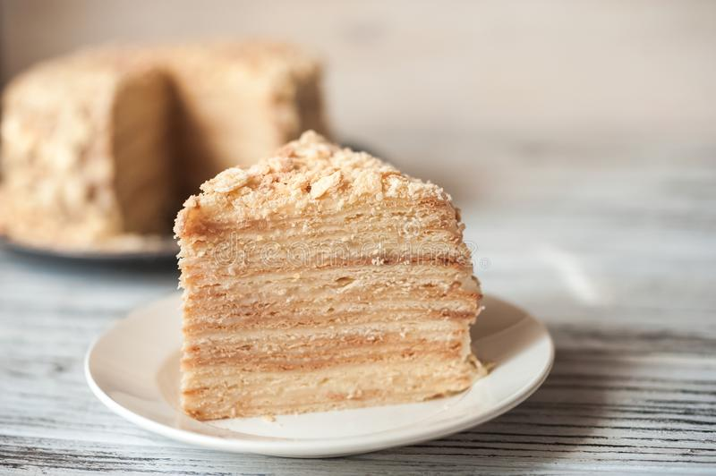 Beautiful appetizing homemade puff cake. Piece of puff stock images