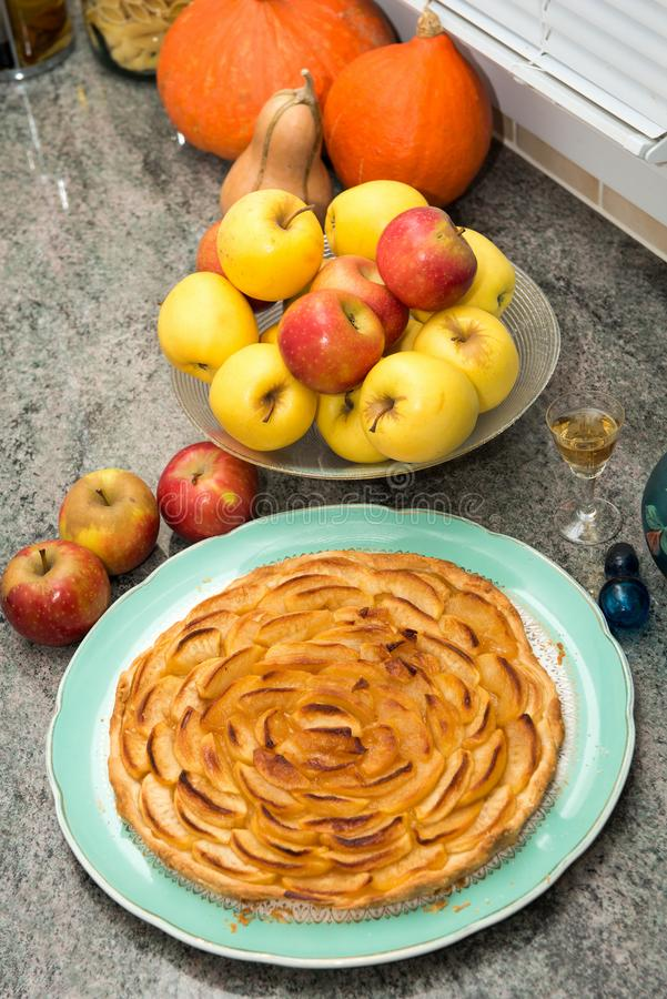 Beautiful apple pie with red and yellow apples. A beautiful apple pie with red and yellow apples stock photos