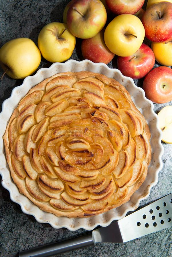 Beautiful apple pie with red and yellow apples. A beautiful apple pie with red and yellow apples stock image