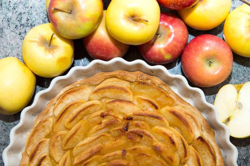 Beautiful apple pie with red and yellow apples. A beautiful apple pie with red and yellow apples stock images