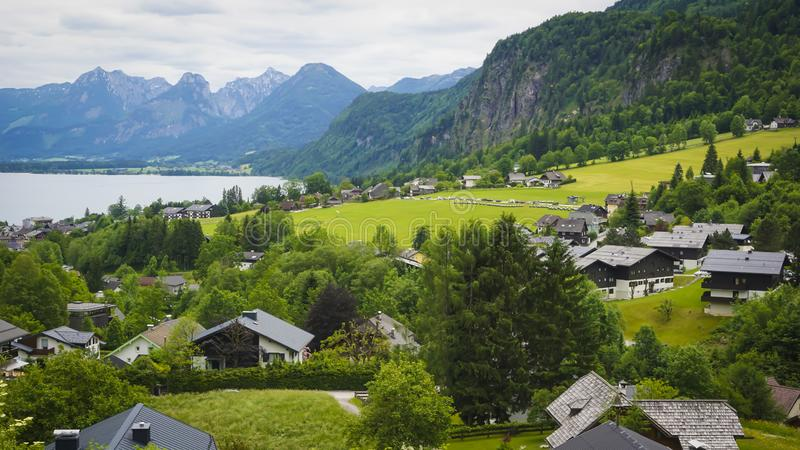 Beautiful Aps landscape with green mountains, valley. Cozy hauses and forest stock image