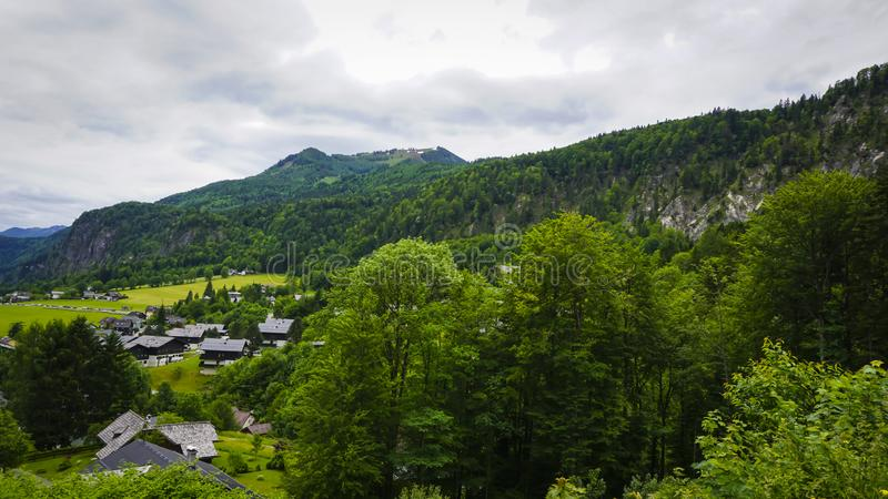Beautiful Aps landscape with green mountains, valley and forest. Beautiful Aps landscape with green mountains, valley, cozy hauses and forest royalty free stock photo