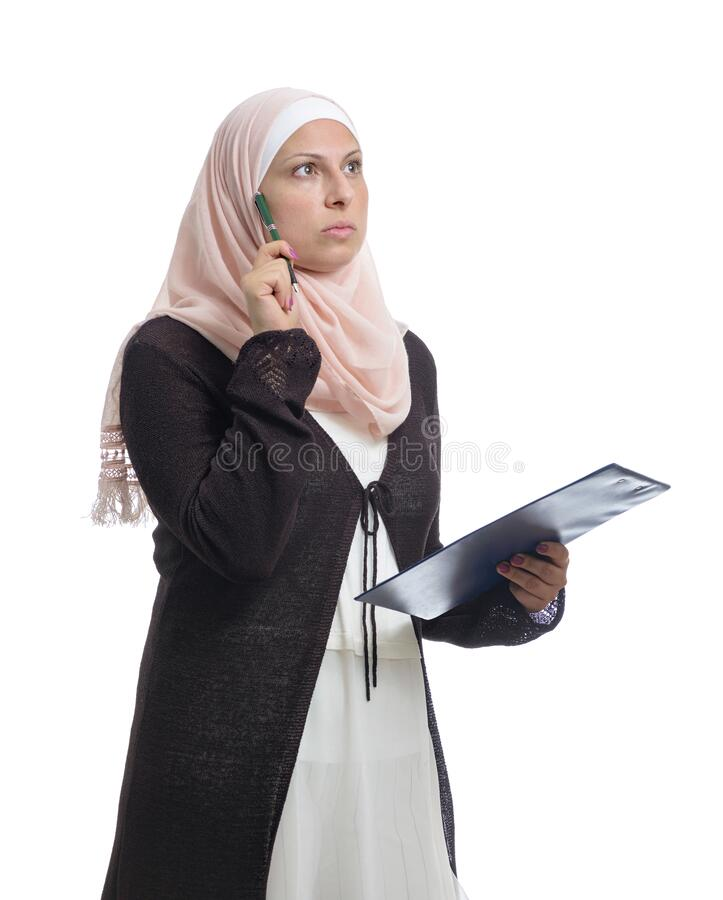 Beautiful Arab Muslim businesswoman looking for a solution, dressed in traditional Islamic clothing royalty free stock images
