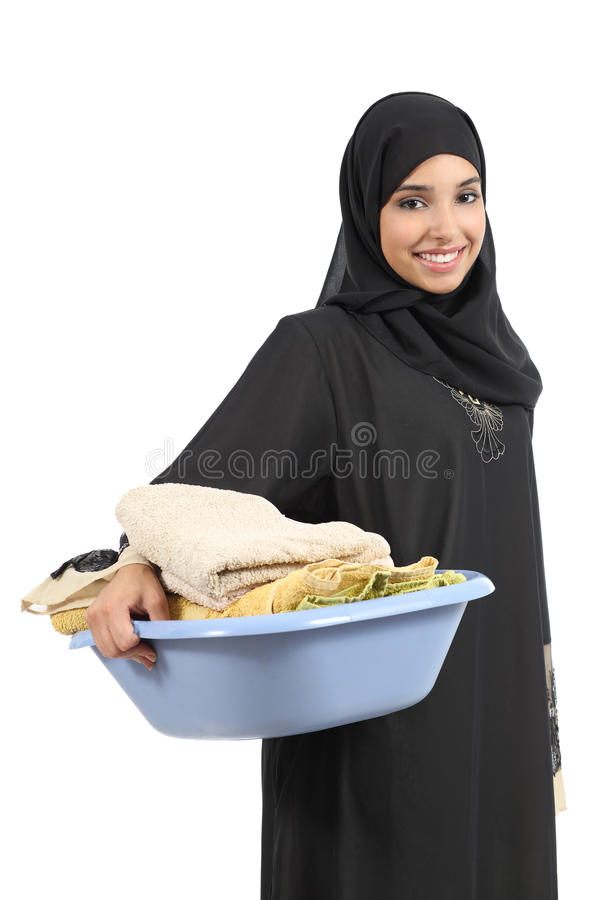 Beautiful arab woman carrying laundry royalty free stock photos