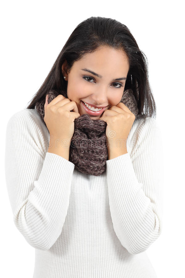 Beautiful arab woman warmly clothed grabbing a scarf. Isolated on a white background royalty free stock photography