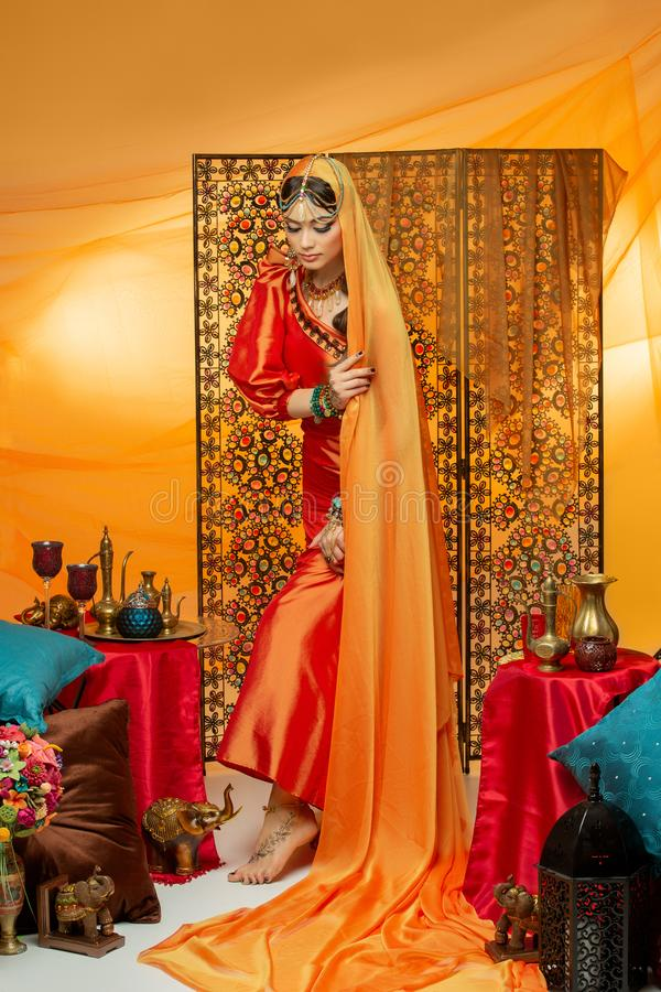 Beautiful arabic style bride in ethnic clothes royalty free stock photography