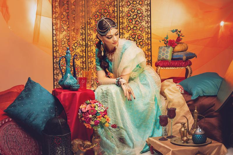 Beautiful arabic style bride in ethnic clothes stock photos