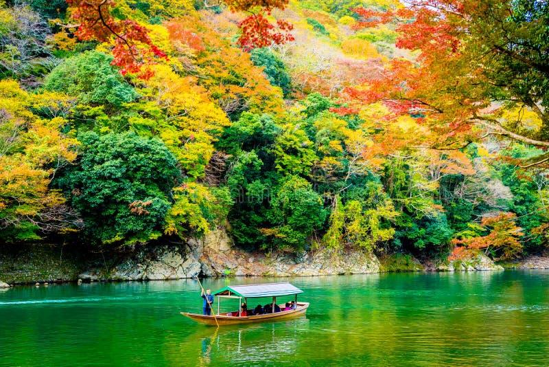 Beautiful Arashiyama river with maple leaf tree and boat around lake. In Autumn season Kyoto Japan royalty free stock photography